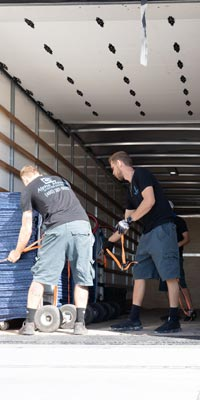 Pictured: Alpha Movers crew unloading a truck.