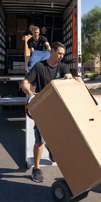 Image: Alpha Movers crew unloading a truck.