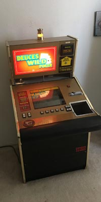 Image: an old arcade machine that Alpha Movers can move.