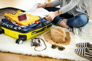 Preparation travel suitcase at home for moving